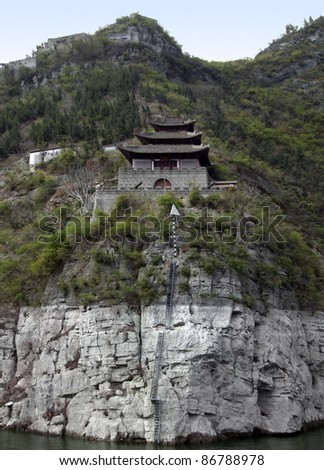 waterside scenery along the Yangtze River in China including a historic fortified building