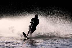 Waterskier silhouette with glowing spray