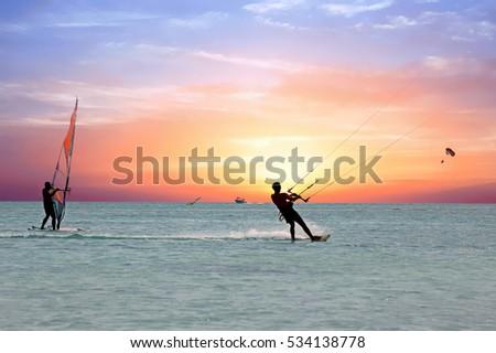Watersport on theCaribbean Sea at Aruba island at sunset