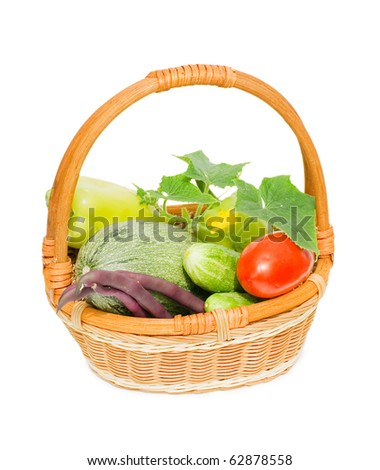 Wattled basket with vegetables isolated on white