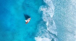 Wave and boat on the beach as a background. 