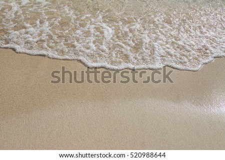 Wave and sand beach for background #520988644
