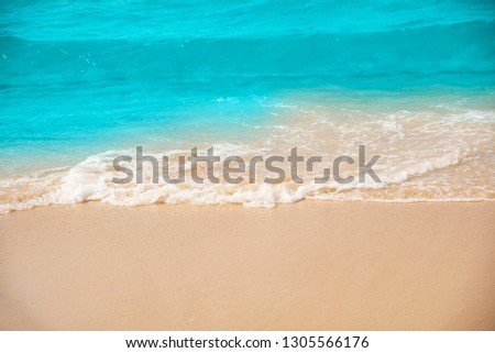 Wave and sand beach for space text or background.
