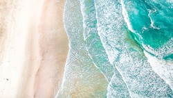 Wave Beach Aerial, Beach on aerial drone top view with ocean waves reaching shore, top view aerial photo from flying drone of an amazingly beautiful sea landscape. Ocean Wallpaper.