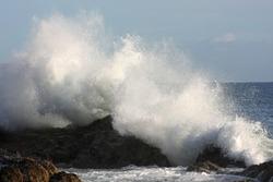 wave brakes on rocks
