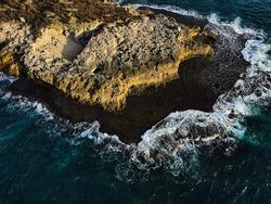 Wave braking on a small island, shot in Israel in Ma'agan Michael