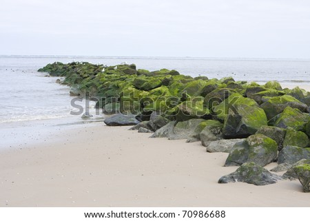 Wave breakers on a Dutch beach in day