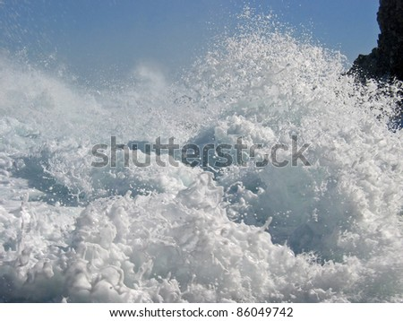 Wave breaking on rocky coast, Mediterranean sea with tramontane wind, Cote Vermeille, Pyrenees Orientales, Roussillon, France