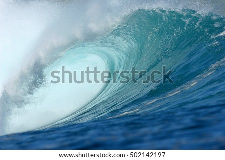 wave breaking over shallow coral reef in indonesia #502142197