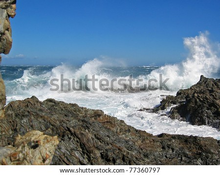 Wave crashing on rocky coast, Mediterranean sea with tramontane wind, Cote Vermeille, Pyrenees Orientales, Roussillon, France