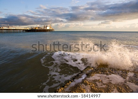 Wave crashing on small pier in Brighton.