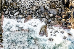 Wave flowing into the rocky area of the cove