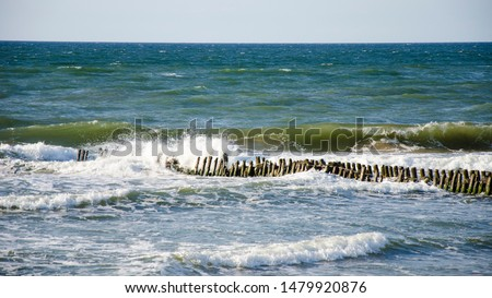 wave impact on the breakwater in the sea #1479920876