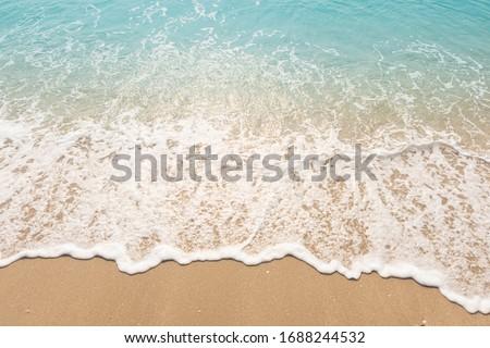 wave of blue ocean on sandy beach. texture Background.