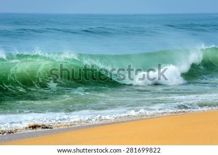 Wave of the ocean on the sand beach