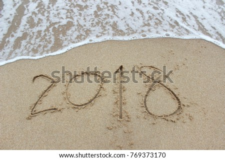 Wave of the sea on the sand and the New Year 2018 #769373170