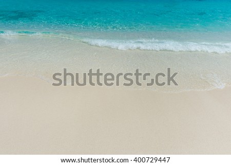 Wave of the sea on the sand beach #400729447