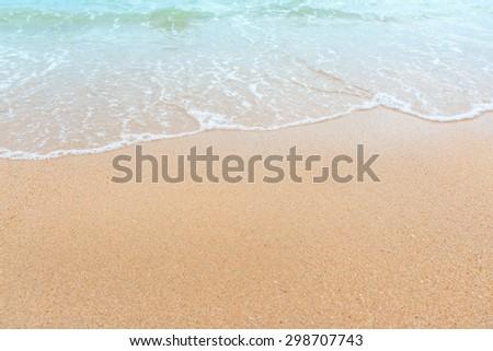 Wave of the sea on the sand beach, summer sand beach background #298707743