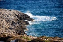 Wave of the sea over the rocks. Lampedusa. Summer 2009.