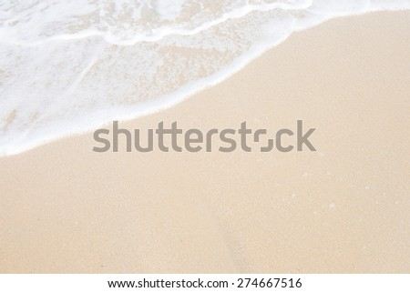Wave roll into beach with white clean foam