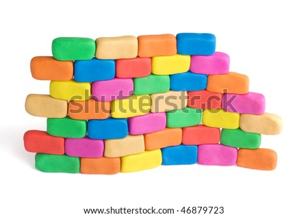 Wave shaped piece of wall made of colorful child's play clay bricks. Flexibility concept