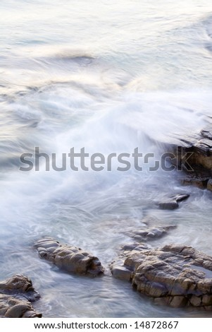 Wave washing on Boiling Pot Rocks, Noosa, Queensland, Australia, using a long exposure to blur water.