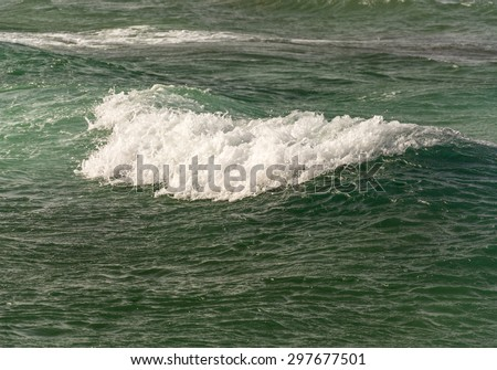 waves and foam on the turquoise, clear and clean sea