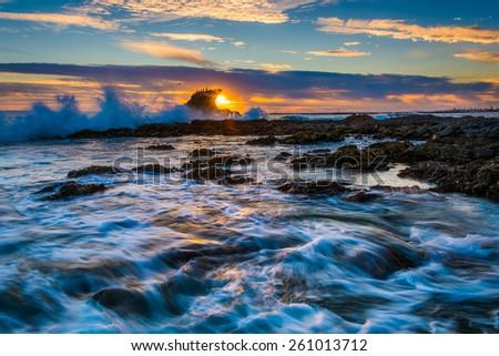 Waves and rocks at sunset, at Little Corona Beach, in Corona del Mar, California. #261013712