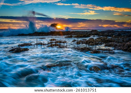 Waves and rocks at sunset, at Little Corona Beach, in Corona del Mar, California. #261013751