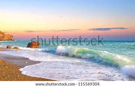 waves and sky during sunset.
