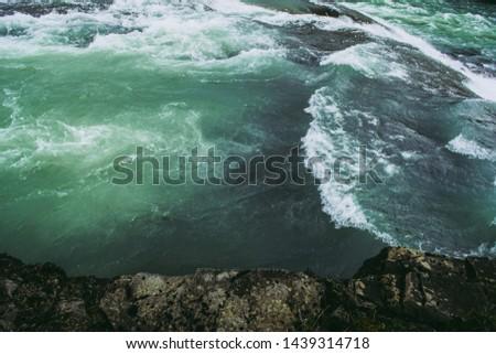Waves and splashes of Hvita river under gray rock, right before Hvita waterfall. #1439314718