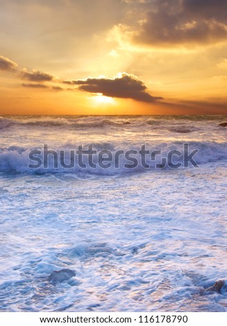 Waves and sundown. Natural composition