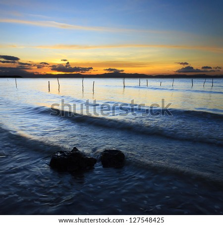 Waves and sunset at a beach in Borneo, Sabah, Malaysia