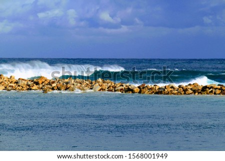 Waves at the Morsens Breakwall. Stockfoto ©