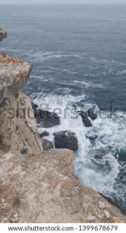 Waves breaking at rugged cliffs of Black Sea coast