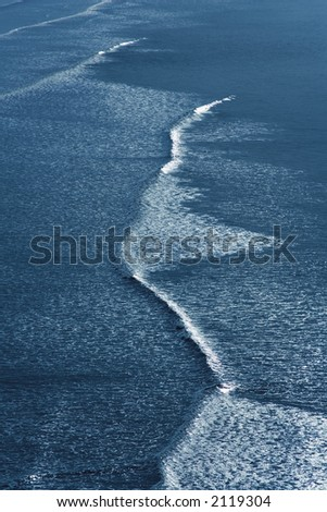 waves breaking on beach - stock photo