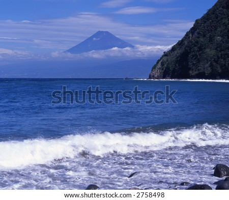 Waves breaking on the coast of Izu with Mt. Fuji in the background