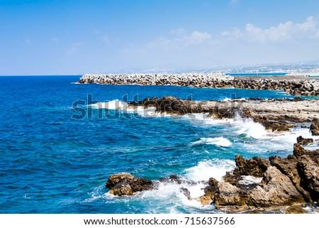 Waves breaking on the rocky coast of the Mediterranean Sea (Sea of Crete) near the Fortress (Fortezza) of Rethymno — Coast of Kolpos Almirou, Crete, Greece #715637566