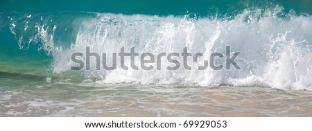 Waves breaking on the shore of Big Beach in Maui - stock photo