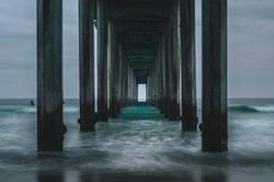 Waves coming in underneath Scripps Pier in La Jolla, San Diego California