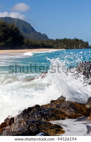 Waves crash onto Lumahai beach on Kauai Hawaii with Na Pali Coast