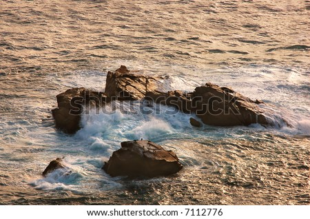 Waves crashing against the rocks, at Cabo da Roca, near Sintra, Portugal (The most western point in Europe) at sunset