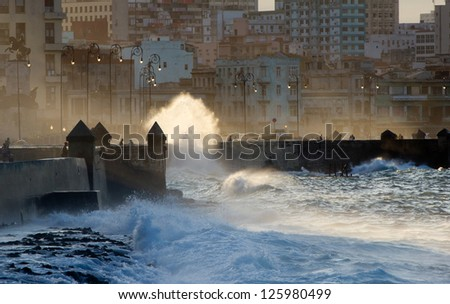 Waves crashing against the sea wall of the Malecon in Havana, Cuba