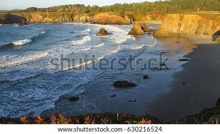 waves crashing along secret...