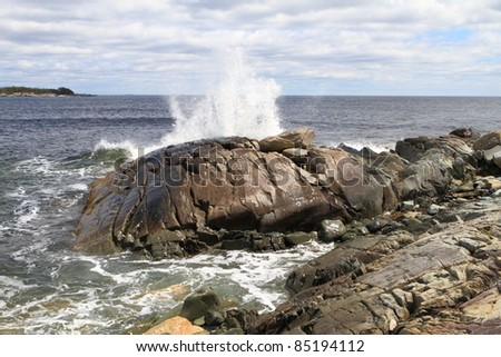 Waves crashing into a rocky coastline
