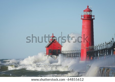 Waves crashing on lighthouse. Grand Haven lighthouse on Lake Michigan. Horizontal format.