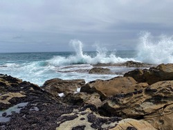 Waves crashing on rocks. Kilcunda surf beach. Victoria. Australia