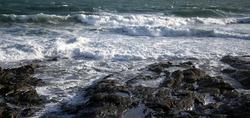 waves crashing on rocks, rugged landscape and coast concept