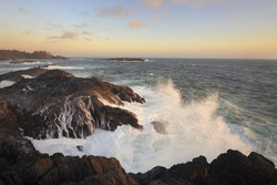 Waves crashing on the rocky shore of Ucluelet at sunset, Vancouver Island, Canada