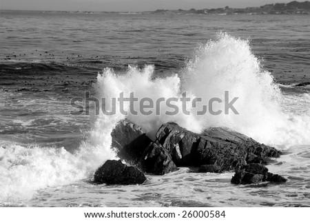 waves crashing onto huge boulders in california